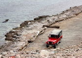 Red jeep at the beach — Stock Photo