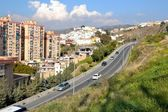 Malaga buildings overlooking one of the mountains — Stock Photo
