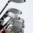 Stock Photo: Golf clubs on white