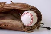 Baseball in mitt isolated on white background — Stock Photo