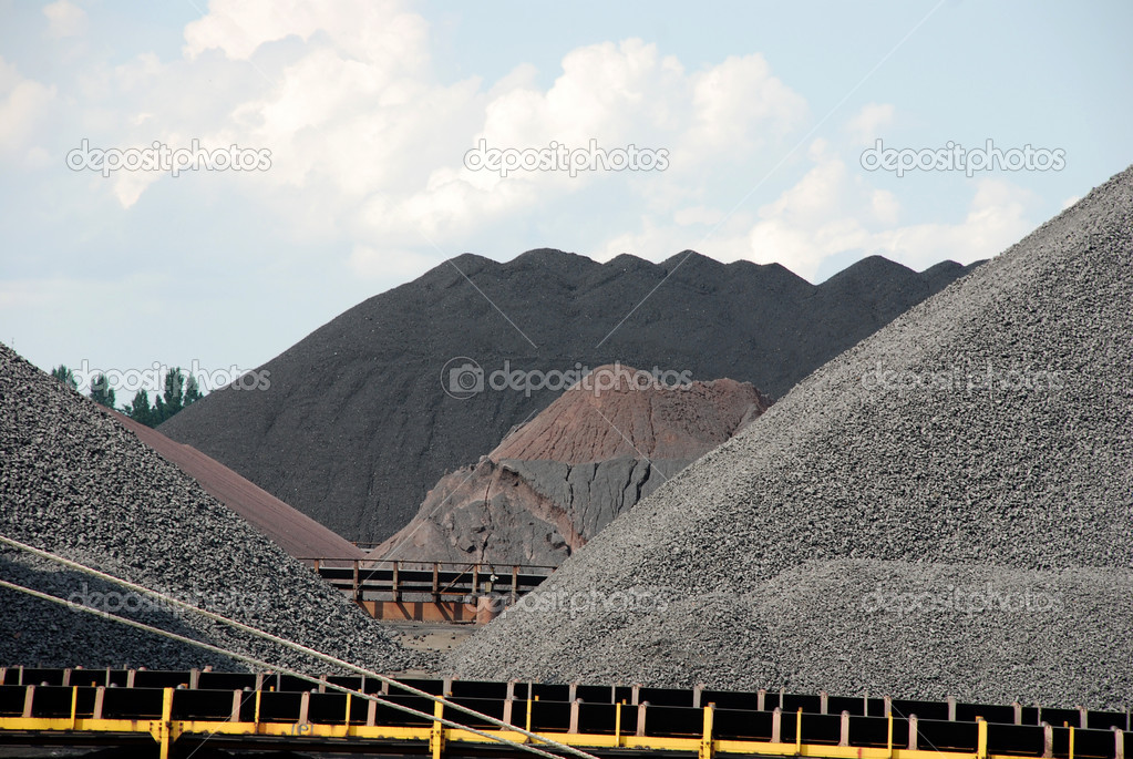 Mountains of coal in the port of Antwerp — Stock Photo #9374735
