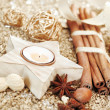 Christmas star candle and spices — Stock Photo