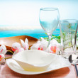 Stylish place setting with orchids — Stock Photo