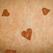 Old-fashioned textured paper with heart — Stock Photo