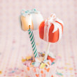 Cake pops as a gift with a candle — Stock Photo