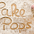 Flour Artwork With Food And Handprints Cake Pops — Stock Photo