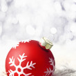 Red christmas bauble with boketh — Stock Photo