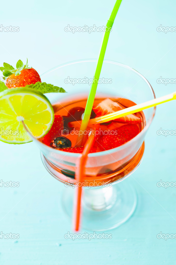 Sangria with colored straws and strawberries in a glass — Stock Photo #8506025