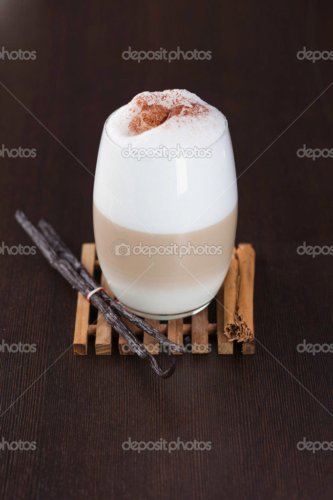 Chai Latte spiced tea beverage in glass mug with spices — Stock Photo #8506073