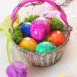 Basket Of Vibrant Marbled Easter Eggs - Stock Photo