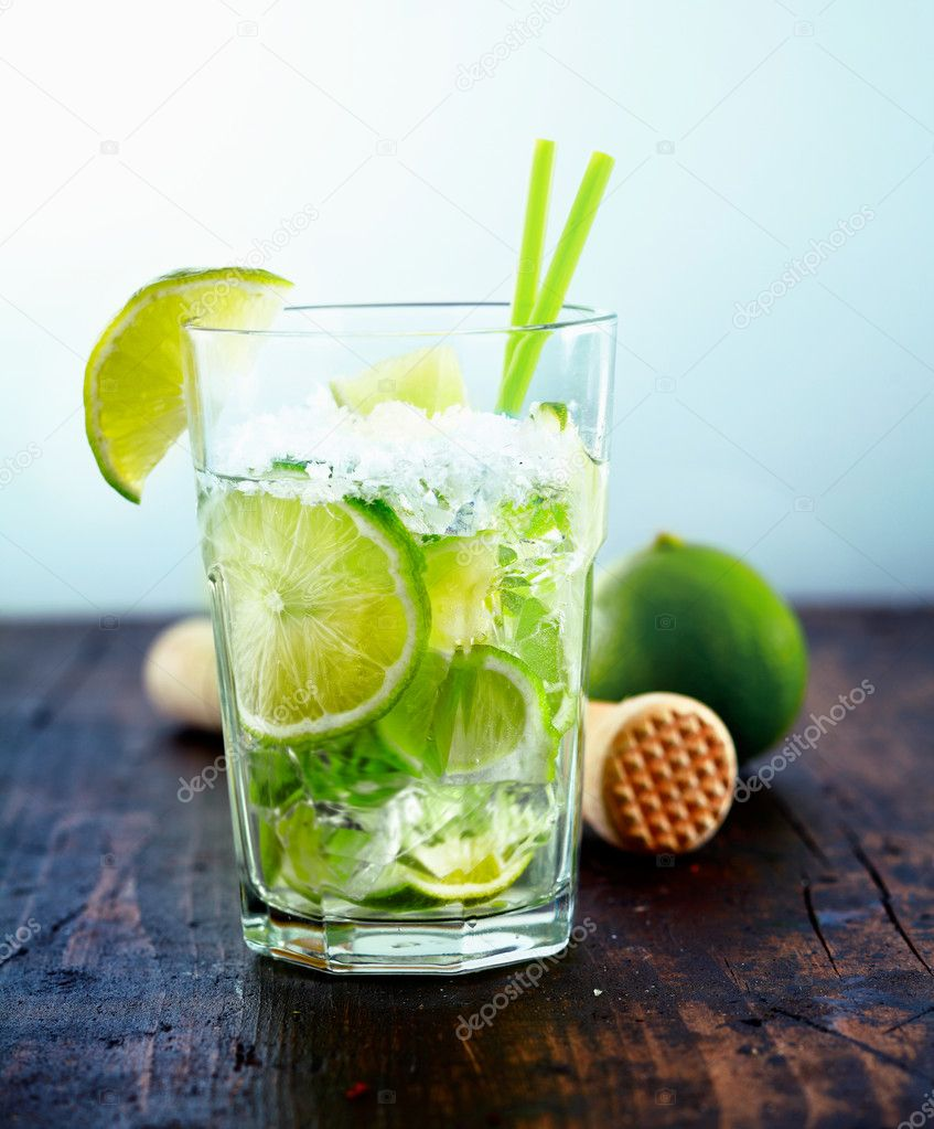 Refreshing cold Caipirinha with fresh lime slices and ice.  Stock Photo #9892174