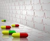 Tablets and ECG — Stock Photo