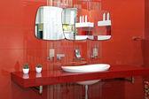 Red bathroom wall — Stock Photo