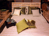 Wooden bed — Stock Photo