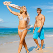 Young Couple on Tropical Beach — Stock Photo #10045415