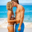 Young Couple Kissing on Tropical Beach — Stock Photo
