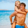 Young Couple on Tropical Beach — Stock Photo #10045550