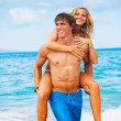 Young Couple on Tropical Beach — Stock Photo #10045558