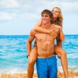 Young Couple on Tropical Beach — Stock Photo #10045560