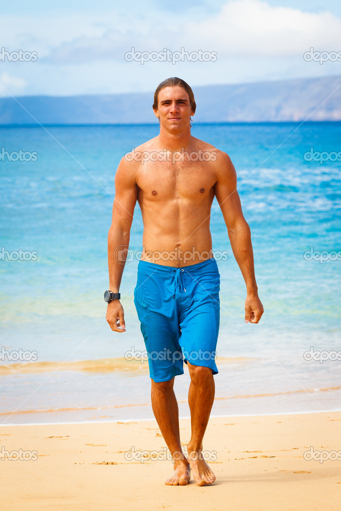 Attractive Young Man on Tropical Beach — Stock Photo #10045564