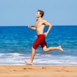 Runner on Beach — Stock Photo #10302391