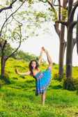Beautiful Woman Practicing Yoga Outside in Nature — Stok fotoğraf