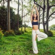 Yoga woman outside in nature — Stockfoto