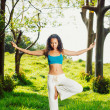 Yoga woman outside in nature — Stock Photo