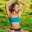 Yoga woman on green grass — Stock Photo