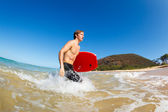 Young Man with Boogie Board at the Beach — Stock Photo