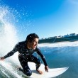 Surfer On Blue Ocean Wave — Stock Photo #8450623