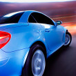 Stock Photo: Fast Sports Car with Motion Blur