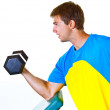 Stock Photo: Athletic Man Lifting Weights in the Gym