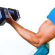 Athletic Man Lifting Weights in the Gym - Stock Photo