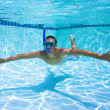 Young Man Swimming in Pool Underwater — Stock Photo #8471435
