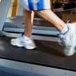 Man Running on Treadmill - Stock Photo
