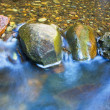 Stock Photo: Water rushing over River Rocks