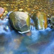 Water rushing over River Rocks - Stock Photo