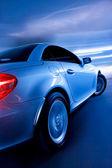 Snelle sportwagen met motion blur — Stockfoto