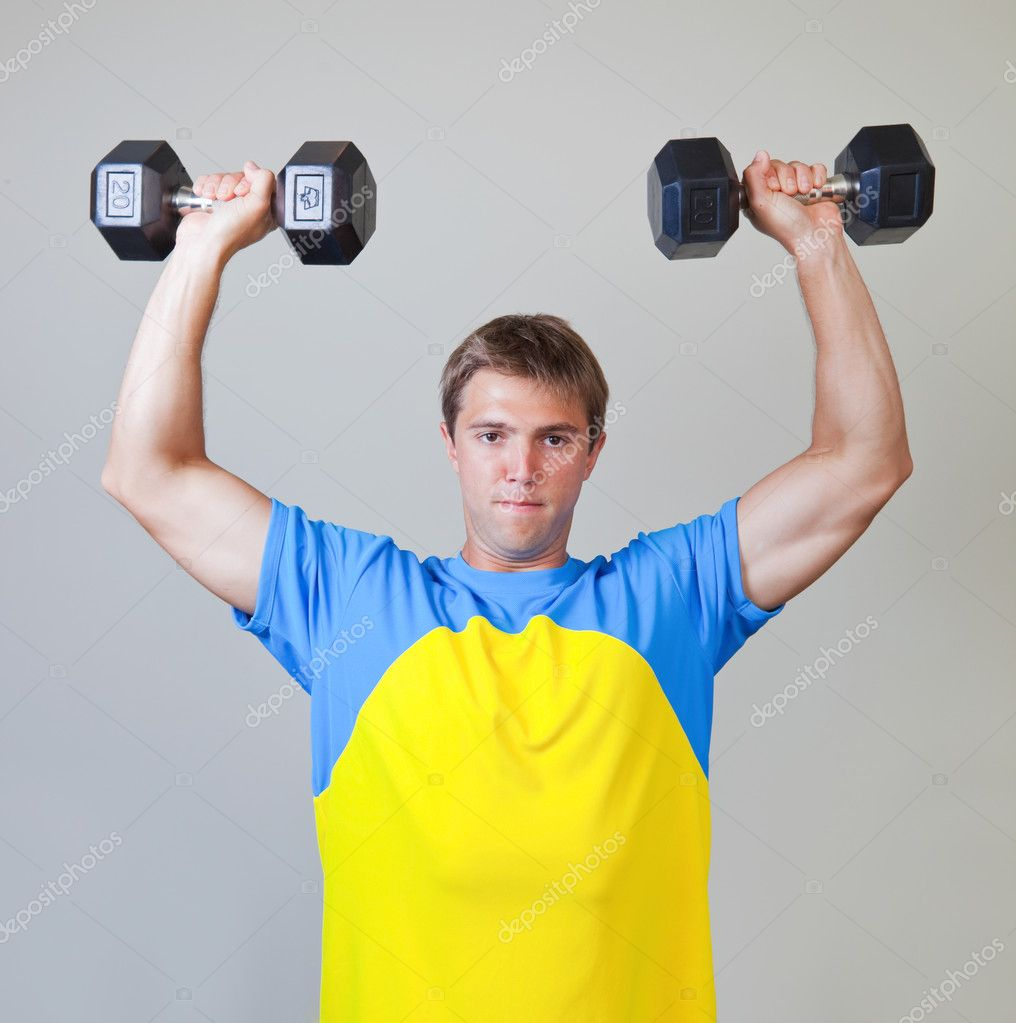 Athletic Man Lifting Weights in the Gym — Stock Photo ...