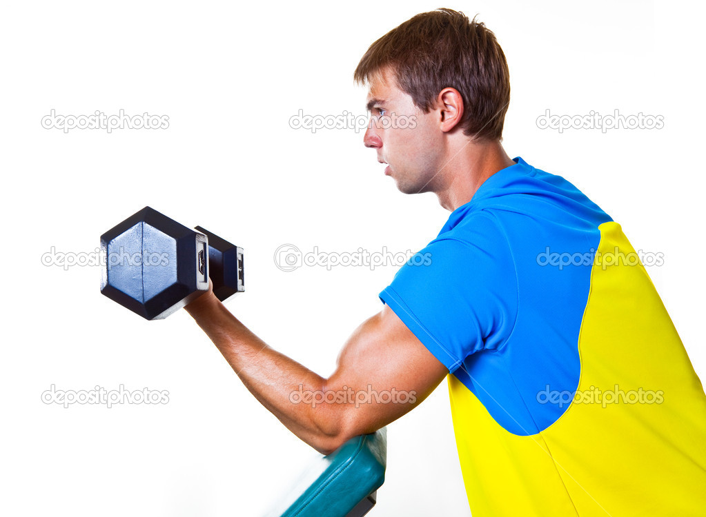 Athletic Man Lifting Weights in the Gym — Stock Photo #8471341