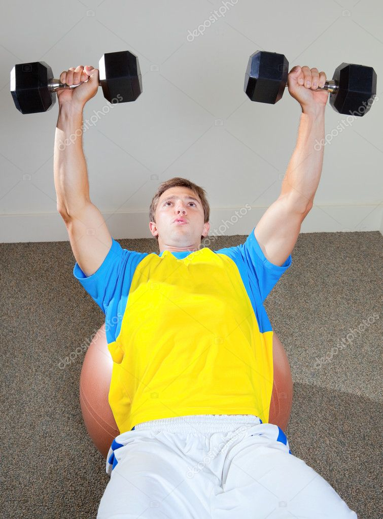 Athletic Man Lifting Weights in the Gym — Stock Photo #8471372