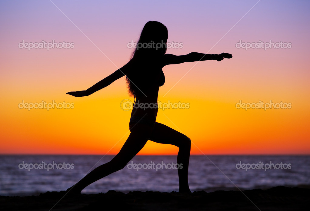 Silhouette of a beautiful Yoga woman at Sunset — Stock Photo #8471432