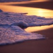 Wave Washing on Sand at Sunset, Shallow Depth of Field — Stock Photo