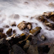 Ocean at sunrise, long exposure, blurred water — Stockfoto