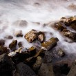 Ocean at sunrise, long exposure, blurred water — ストック写真