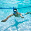 Young Man Swimming Under Water In Pool - Stockfoto