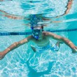 Young Man Swimming Under Water In Pool - Lizenzfreies Foto