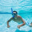Young Man Swimming Under Water In Pool — Stock Photo #8615963