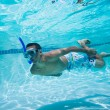 Young Man Swimming Under Water In Pool - Stok fotoğraf